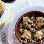Plato de conejo con caracoles. Restaurante La Rueda. Pueblo de CHULILLA. Valencia. Comunidad Valenciana. España