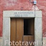 Detalle de una inscripción en el dintel de una puerta. Población de CUACOS DE YUSTE. Provincia de Caceres. Extremadura. España - Spain