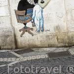 Comic de un pintor y su niño por Millard. Pared de un edificio. Ciudad de ANGOULEME / ANGULEMA. Francia