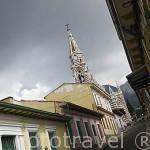 Calle colorida y la iglesia del Carmen. BOGOTA. Colombia